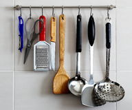 Kitchen Utensils Rack on the Wall. Kitchen Utensils Hanging Tidily From a Stainless Steel Rack Stock Photos