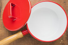 Kitchen utensils red cooking pot Royalty Free Stock Photos