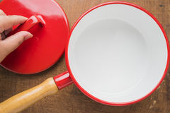 Kitchen utensils red cooking pot Royalty Free Stock Image