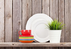 Kitchen utensils on shelf Stock Photo