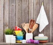 Kitchen utensils on shelf Stock Image