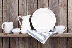Kitchen utensils on shelf stock photos