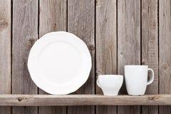 Kitchen utensils on shelf stock images