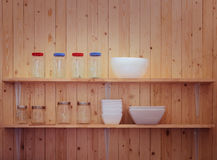 Kitchen utensils on shelves Royalty Free Stock Photography