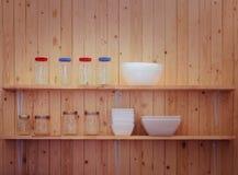 Kitchen utensils on shelves Royalty Free Stock Photography