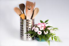 Kitchen utensils with a smile and a flower. Wooden kitchen utensils with a smile and a nice flower Royalty Free Stock Image
