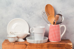Kitchen utensils and tableware on wooden board. Over rustic background royalty free stock photo