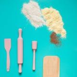 Kitchen utensils on turquoise background. Stock Photos