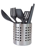 Kitchen utensils in a utensil holder. Isolated against a white background Stock Photos