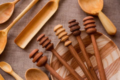 Kitchen utensils. Various handmade wooden kitchen utensils on vintage background Stock Images