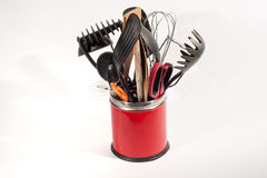 Kitchen Utensils. Various Kitchen utensils in a red pot isolated on a white background stock image