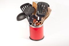 Kitchen Utensils. Various Kitchen utensils in a red pot isolated on a white background royalty free stock photos