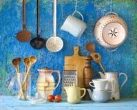 Kitchen utensils. Various vintage kitchen utensils,against blue wall, cooking concept stock photo