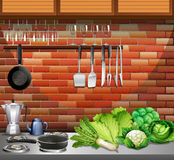 Kitchen with utensils and vegetables Stock Photo