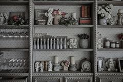 Kitchen utensils in a vintage cabinet in a restaurant Stock Image