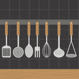 Kitchen utensils weighs on a wall in the kitchen. Stock Photos