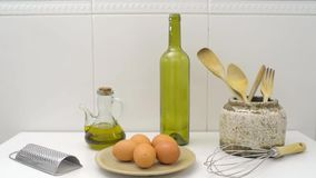 Kitchen utensils on white table. stock footage