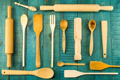 Kitchen utensils on wooden background. spoon, mortar, kitchen spatula Royalty Free Stock Photos