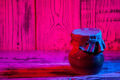 Kitchen utensils on wooden blue red purple gradient background. Close up Royalty Free Stock Photos