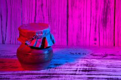 Kitchen utensils on wooden blue red purple gradient background. Close up Royalty Free Stock Photo