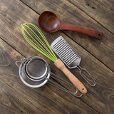 Kitchen Utensils. On wooden table, from above Royalty Free Stock Photo