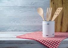 Kitchen utensils on wooden table Stock Image