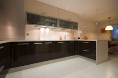 Kitchen V. Modern kitchen with cream and chocolate cupboards and steel hood Royalty Free Stock Image