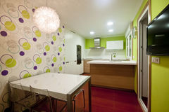 Kitchen Vigo. Modern kitchen with white and wood cupboards and steel hood stock images