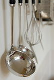 Kitchen ware. Hanging on the wall ready to be used stock images