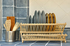 Kitchen ware. On platform with shelf, shown as home life and fine or clean home environment Stock Images