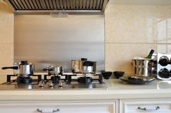 Kitchen ware and appliance. Part of kitchen with kitchen ware and appliance, such as stainless steel pot and container, and kitchen range, shown as home related Royalty Free Stock Photography