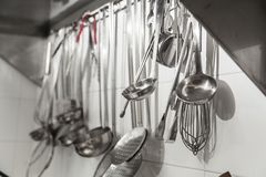 Kitchen ware hanging from a wall. royalty free stock image
