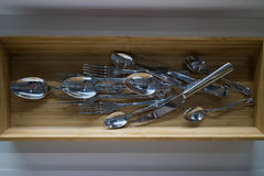 Kitchen ware hanging on the wall. With many spoons and forgs Stock Images
