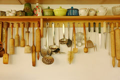 Kitchen ware hanging on the wall. Royalty Free Stock Photos