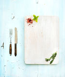 Kitchen-ware set. White wooden chopping board Royalty Free Stock Photo