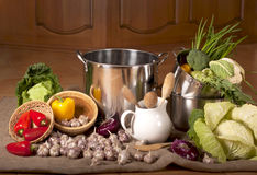 Kitchen ware and vegetables Stock Image