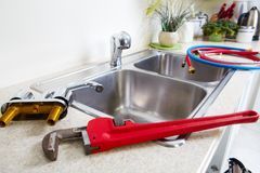 Kitchen Water tap and sink. Renovation and plumbing royalty free stock photos