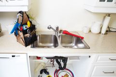 Kitchen Water tap and sink. Royalty Free Stock Images
