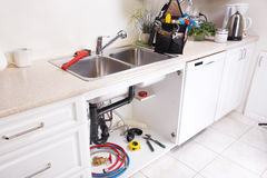 Kitchen Water tap and sink. Renovation and plumbing stock photography