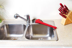 Kitchen Water tap and sink. Renovation and plumbing stock photos