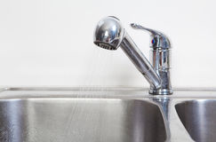Kitchen Water tap and sink. Stock Image