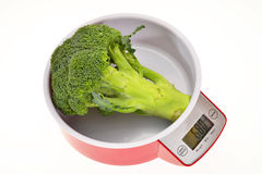 Kitchen Weighing Scale With Broccoli Stock Photo
