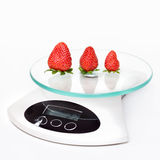 Kitchen weight scale with strawberry Stock Photo