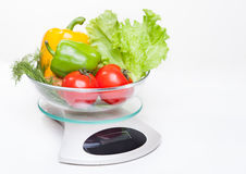Kitchen weight scale with vegetables. Royalty Free Stock Photography
