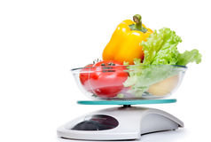 Kitchen weight scale with vegetables. Stock Images