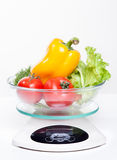 Kitchen weight scale with vegetables Stock Image