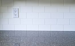 Kitchen White Backsplash. White Kitchen backsplash with a white outlet on the left side with quartz countertop royalty free stock images