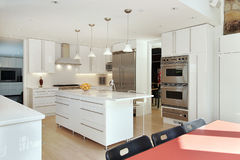 Kitchen with white cabinetry Royalty Free Stock Images