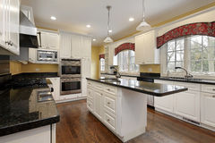 Kitchen with white cabinetry stock photos