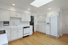 Kitchen with white cabinetry Stock Photo